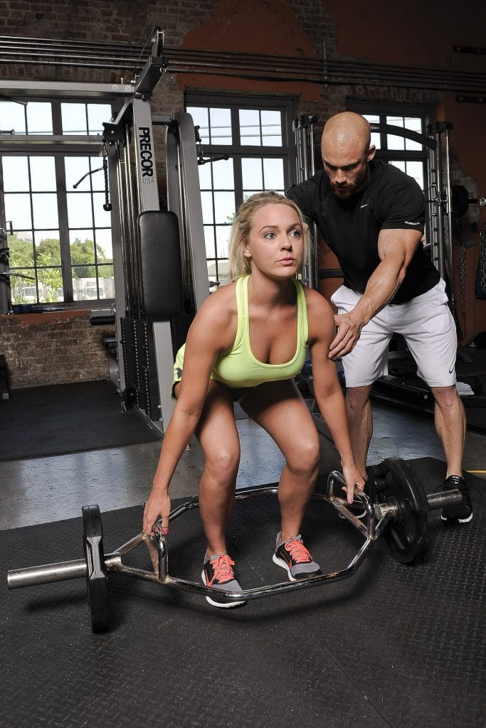 Lifting with a spotter - female bodybuilding
